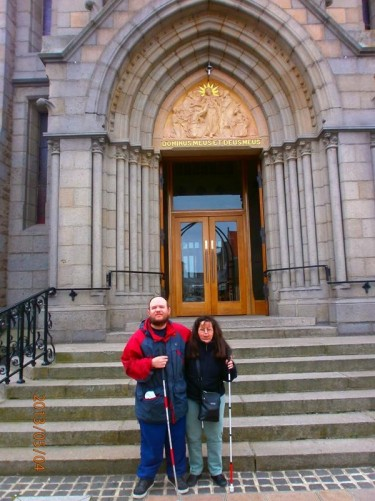 St Thomas' Church. Tony and Tatiana at the foot of steps leading to the main doorway. This Catholic church opened in 1885. It is the largest church on the Channel Islands.