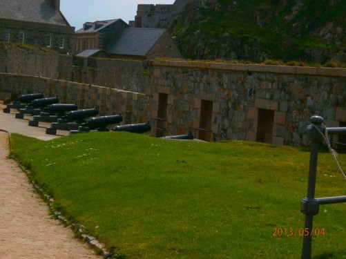 Lower Ward: A row of canons pointing through a crenellated wall.