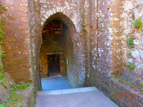 A passageway with steps leading through the castle walls.