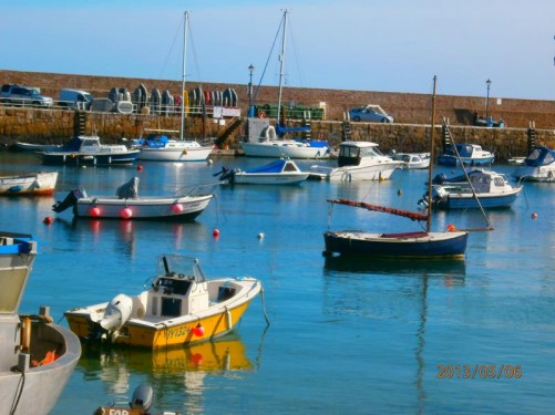 Lots of small boats in Gorey Harbour. The harbour wall in the background.