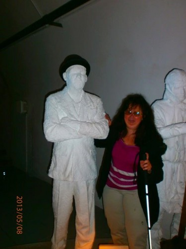 Tatiana between a pair of male mannequins. Jersey War Tunnels, near St Laurance. Photo taken in the former German World War II underground hospital that was built by prisoners of War. It's now a museum.