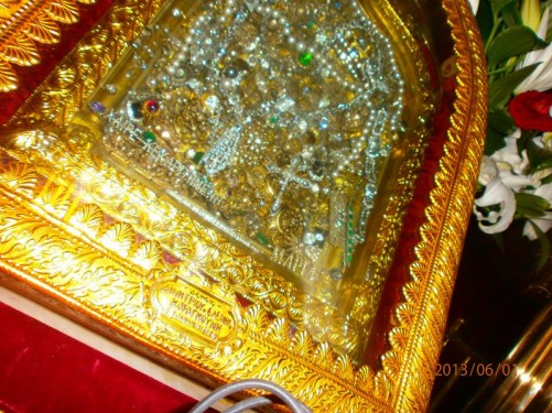 The holy icon now almost completely encased in silver, gold and jewels. It depicts the Virgin Mary kneeling with her head bent in prayer.
