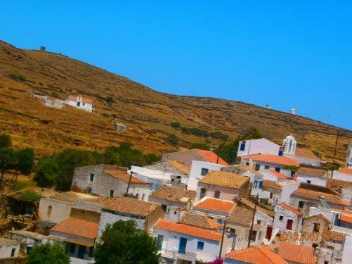 View across the rooftops of Dryopida to a hill beyond.