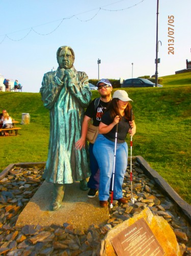 Tatiana and Tony by a statue of Sir William Hillary (1771 - 1847). Hillary was a soldier, author and philanthropist, best known as the founder of the Royal National Lifeboat Institution in 1824. The statue is at Douglas Head, a headland, which overlooks Douglas Bay.
