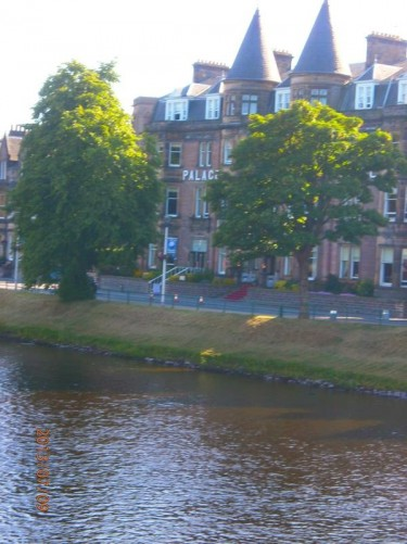 View across the River Ness from near Ness Bridge. The Palace Hotel on the opposite bank.