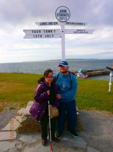Tony and Tatiana by the famous signpost at John O'Groats.