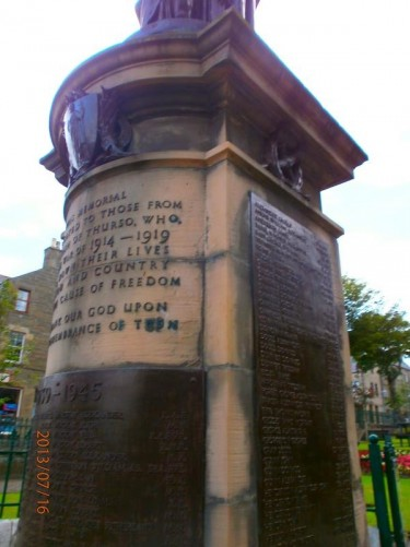 Thurso War Memorial located in Sir John's Square. On top of the memorial is a bronze statue which depicts Victory, he is resting his hand on the head of a small boy, representing Peace. The names of locals who died during both world wars are engraved on metal plaques on the base.