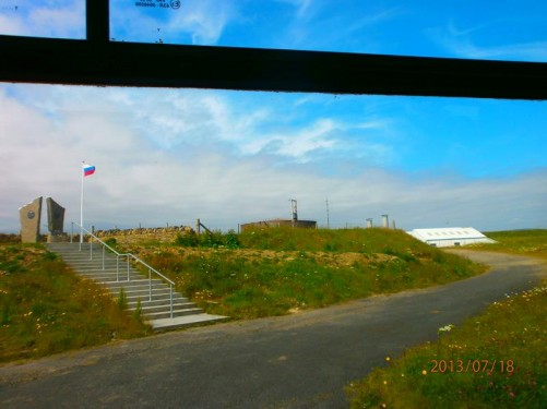 Passing by the Arctic Convoy Memorial at Lyness. A memorial to the men who perished in the Russian convoys during World War II. A Russian flag flying from a pole.
