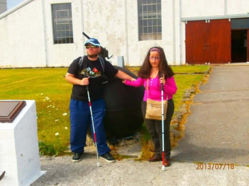 Tatiana and Tony touching an old sea mine outside the museum.