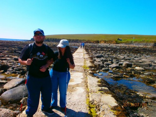 Tatiana and Tony on the causeway having crossed back from Brough of Birsay, which is in view behind.