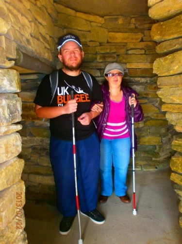 Tony and Tatiana inside a rebuilt stone house at Skara Brae.