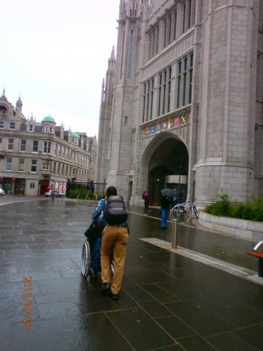 Again on Broad Street looking at the Marischal College façade and entrance gate archway.