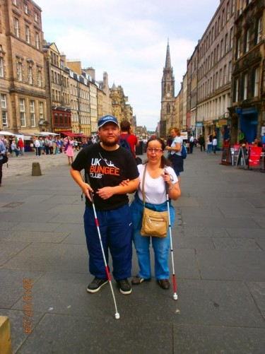 Tony and Tatiana on Royal Mile. The Royal Mile is the name given to a succession of streets forming the main thoroughfare of the old town of the city of Edinburgh. The route is lined with shops, restaurants, pubs, and visitor attractions.