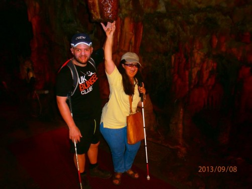 Now in Drogarati Caves, again located close to Sami. Tony and Tatiana touching the bottom of a large stalactite. The cave is entered via a 44 metre long descending passageway that leads to a chamber of about 30 by 40 metres. The cave has excellent acoustics, and is sometimes used for concerts, performed on a special platform.