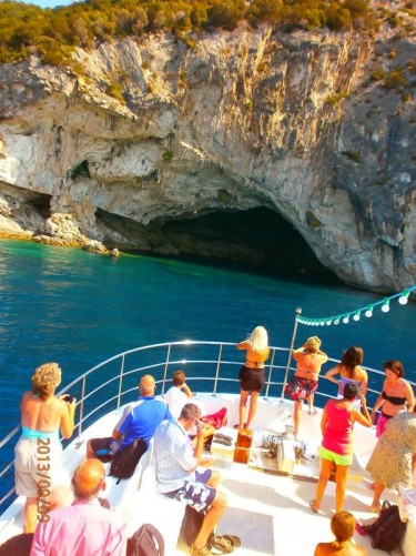 The boat approaching a large famous sea cave at Meganisi. The cave was used in World War II to hide Italian warships and was attacked by a Greek submarine.