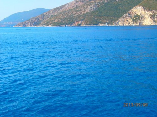 View of the coastline of Lefkada. The island's rocky slopes continuing right down into the sea.
