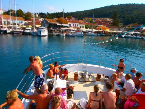 Fellow passengers relaxing at the front of the boat. The boat back in Fiskardo harbour on the return trip.