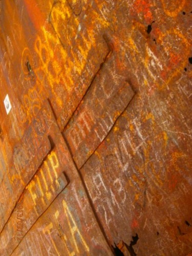 Graffiti on the side of the wrecked ship.