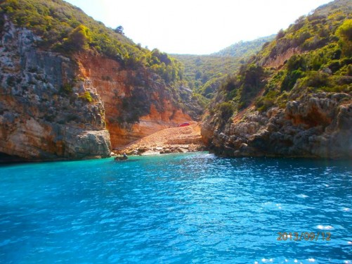 Looking into a small isolated cove. Cliffs at either side.