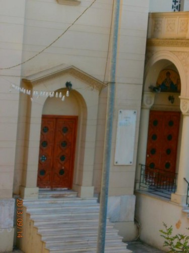 A pair of doorways into a Greek Orthodox church.