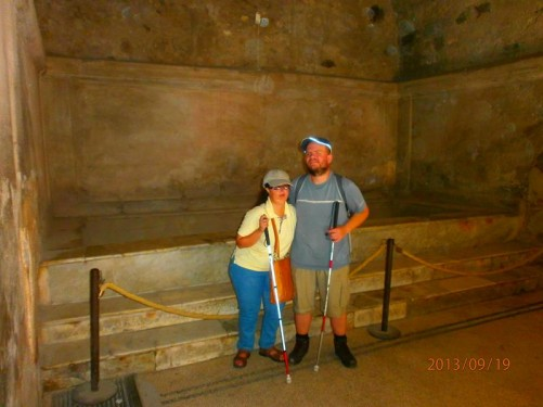 Tony and Tatiana at the foot of marble steps used to enter a large bath.