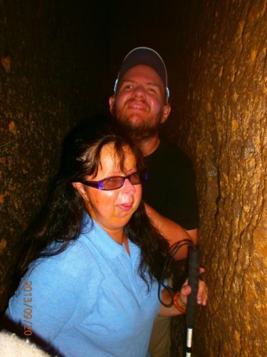 Another view of Tony and Tatiana moving down the narrow passage.