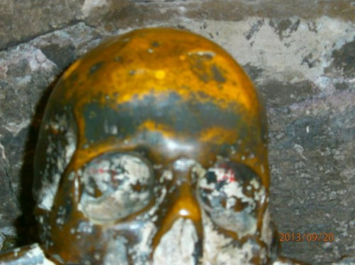 Close-up of a skull cast in metal.
