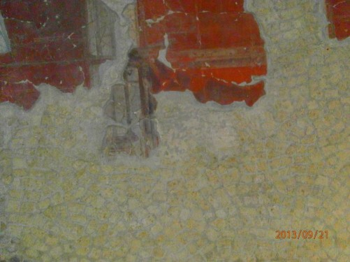 Close-up of part of a decorative wall-painting inside a house.