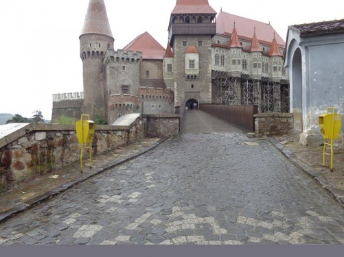 Outside Hunedoara (Corvin) Castle, Hunedoara town, in the rain. Looking towards the main entrance accessed via a wooden bridge, which passes over the Zlaști River, flowing 30 metres beneath.