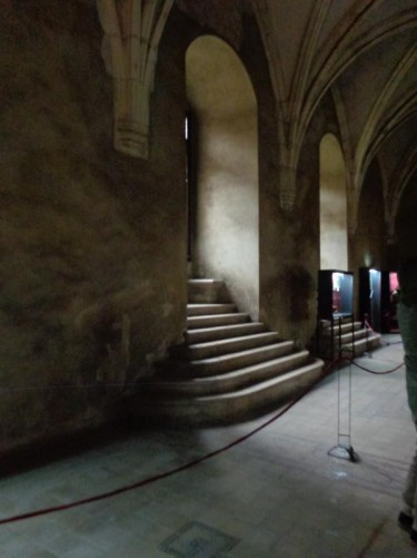 Inside the Great Hall. Vaulted ceiling. Steps leading up to two doorways.
