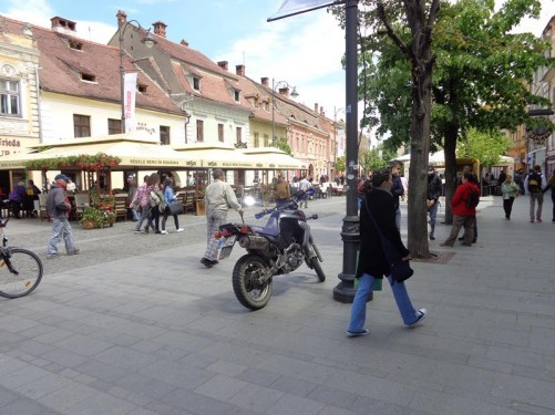 View along Strada Nicolae Bălcescu: a wide pedestrian street in Sibiu's Upper Town. It is the main street in this area and lined with historic buildings containing cafés and shops.