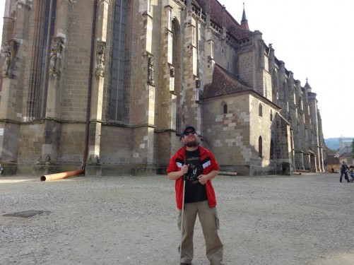 Tony at the side of the Black Church. The church is approximately 85 metres (278 feet) long with tall buttressed stone walls and elongated gothic windows. The Black Church is the largest gothic church between Vienna and Istanbul.