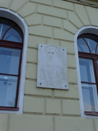 A stone plaque on the side of a building dedicated to Aurel Vlaicu (1882 – 1913). He was an engineer, inventor, airplane constructor and early pilot.