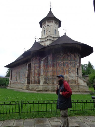 Tony next to the Church of the Annunciation at Moldovița Monastery. Situated in the commune of Vatra Moldoviței, Suceava County. Built in 1532 by Petru Rareș, who was Stephen the Great's illegitimate son. The frescoes, which cover the exterior and interior walls, were painted in 1537.