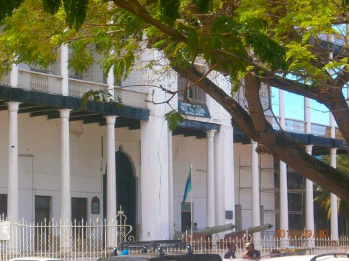 Outside the House of Wonders (or 'Palace of Wonders', also known as 'Beit-al-Ajaib') in Mizingani Road on the seafront. Canons either side of the main entrance.