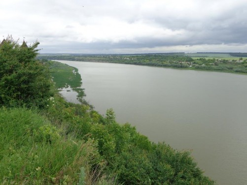 View across and along the wide Dniester River. Countryside on the far side.
