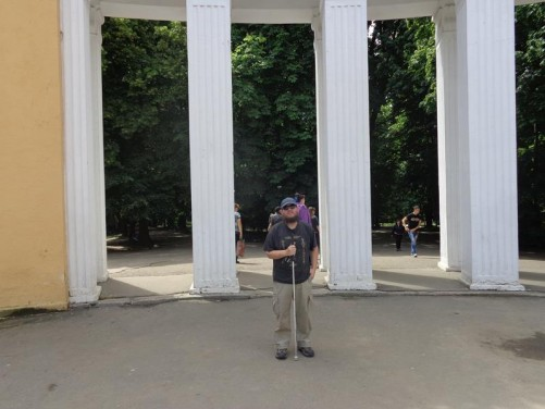 Tony in front of ornamental concrete pillars in Shevchenko Central Park.