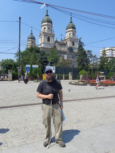 Tony outside the Metropolitan Cathedral. Three of the cathedral's four towers are visible.