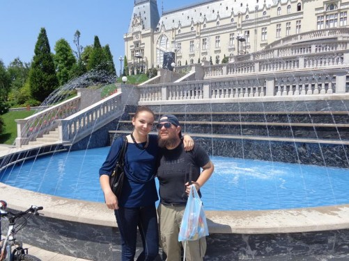 Larisa and Tony in front of a fountain outside the Palace of Culture.
