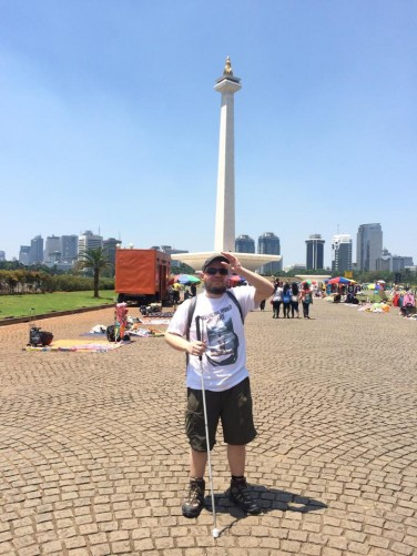 Tony in front of the National Monument located in Merdeka Square in central Jakarta. The Monument was built to commemorate Indonesia's struggle for independence. It stands at 132 metres (433 feet) in height.