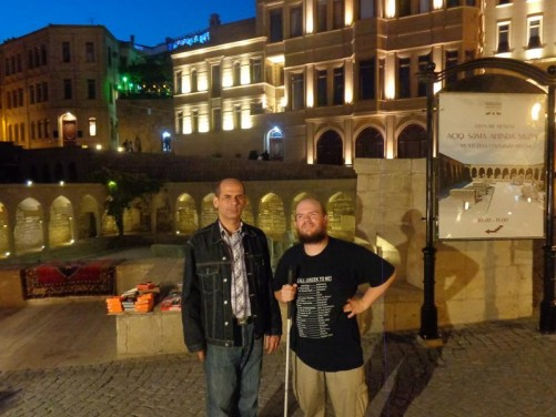 Evening. Tony standing with a local man next to the Ancient Market. The market is surrounded by colonnades and arches and sits several metres below today's street level.