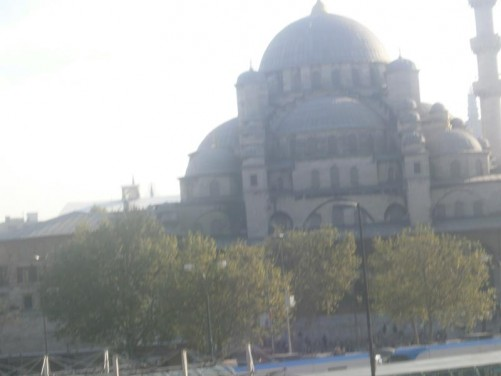 The New Mosque (Yeni Cami). The main dome can be seen standing at 36 metres in height. It is surrounded by 66 smaller domes and semi-domes. One of the two minarets can be seen on the right side. Construction began in 1597, but was abandoned due to political discontent in 1603. The building then stood as a ruin until work restarted following the Great Fire of Istanbul in 1660 and was completed in 1665.