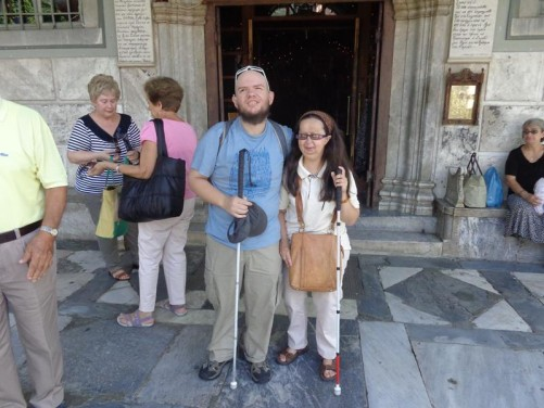Tony and Tatiana outside the main doorway into the Church of Panayia.