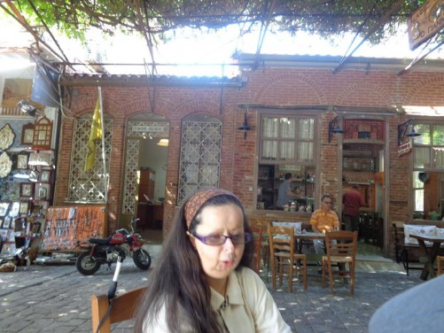 Tatiana relaxing in a shaded seat, outside a café. Near the Church of Panayia.