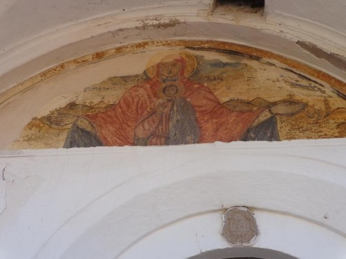 Fresco above a doorway into the Church of Glykfylousa Panagia. The first church was built here in 1609 and the present one dates from 1747.