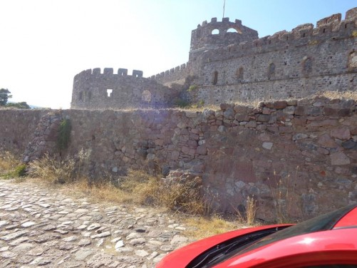 Outside Mytilene Castle. This very large castle covers an area of 60 acres. The first castle on this site is believed to have been erected during the time of Justinian I in the 6th-century AD, although this is believed to be on the ruins of an even more ancient fortification.