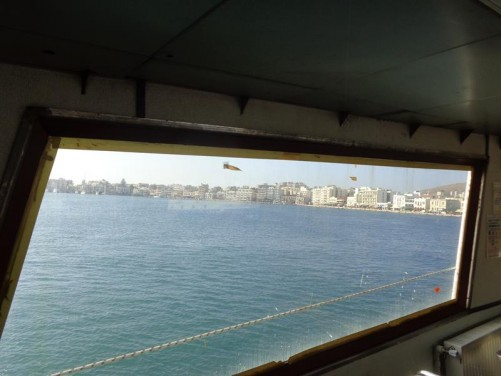 View of Çesme town approaching through a ferry window.