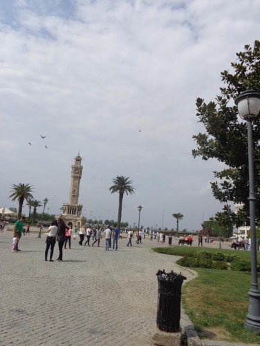 Looking across Konak Square to Izmir Clock Tower, one of the city's main landmarks. The Clock Tower was built in 1901 to commemorate the 25th anniversary of Abdülhamid II's accession to the throne. It is 25 metres (82 feet) in height and features four fountains (sadirvan), which are placed around the base.