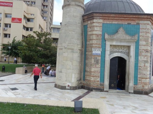 The main doorway into Yali Mosque with the base of the minaret to the left side.