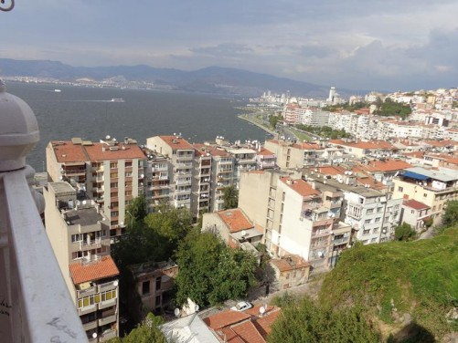 View across Izmir Bay from a viewing platform. The platform is at the top of an historic elevator in Izmir's Karatas quarter. The elevator was built in 1907 by Nesim Levi Bayraklioglu, a local Jewish banker and trader, to facilitate access up a steep cliff separating Karatas's narrow coastal strip from the land above.